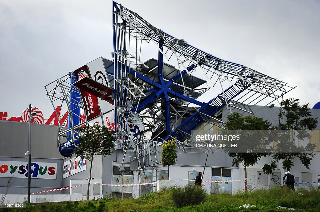 A picture taken on January 19, 2013 shows damages after strong wind hit a shopping mall in Sevilla. The interior ministry issued an alert for the weekend, warning of snow and rain storms across the country with winds up to 100 kilometres per hour (62 mph) and rough seas in the Mediterranean.