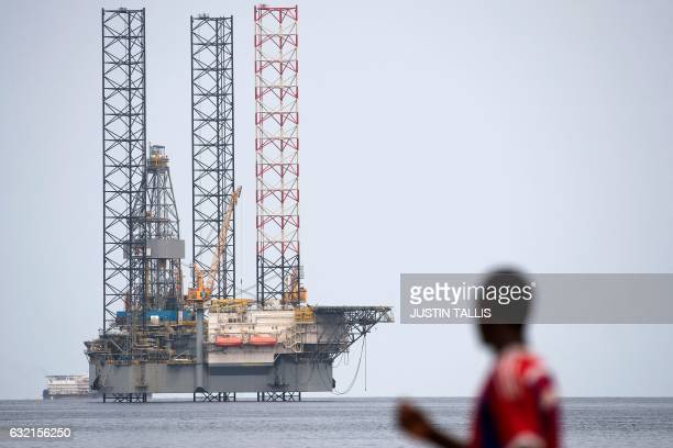 Picture taken on January 19, 2017 shows an off-shore oil rig, off the coast of Port-Gentil in Gabon. / AFP / Justin TALLIS
