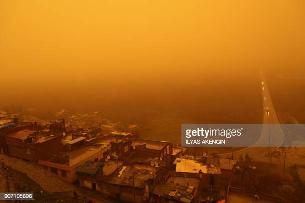 TOPSHOT A picture taken on January 19 2018 shows a general view of Diyarbakir city during a sandstorm on January 19 2018 in Diyarbakir / AFP PHOTO /...