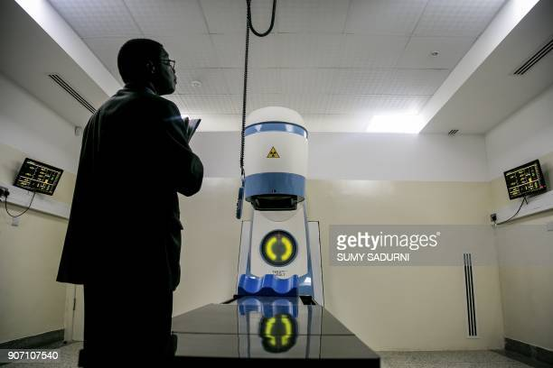 TOPSHOT A picture taken on January 19 2018 shows a new Cobalt 60 Radiotherapy Machine being installed at Mulago hospital in Kampala Uganda Uganda's...
