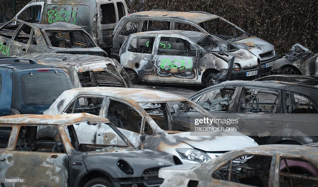 A picture taken on January 1st, 2013 shows burnt cars collected by city employees during the New Year's eve in Strasbourg, eastern France.
