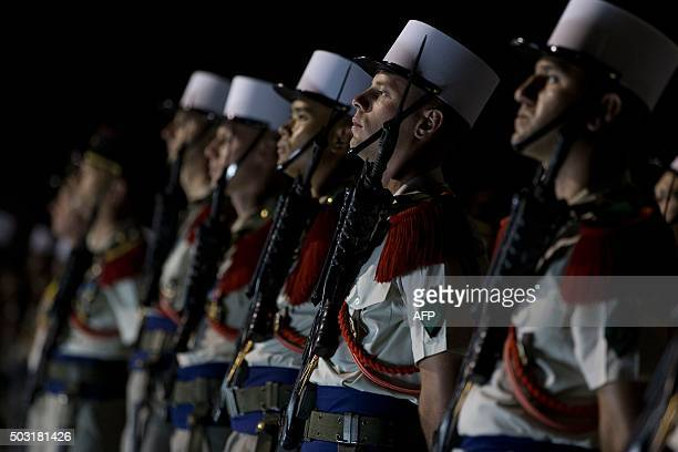 A picture taken on January 2 2016 shows members of the 13th DemiBrigade of the Foreign Legion standing during a visit of French Defence minister to...