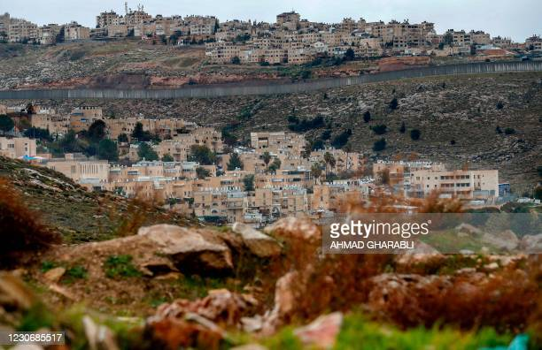 Picture taken on January 20, 2021 shows Israel's controversial concrete barrier separating the Jewish settlement of Pisgat Zeev in the northern part...