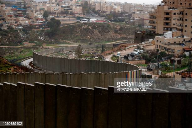 Picture taken on January 20, 2021 shows the Israeli settlement of Pisgat Zeev , built in a suburb of the mostly Arab east Jerusalem, and the...