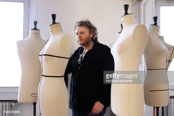 A picture taken on January 21 2010 in Paris shows Dutch designer Josephus Thimister posing for the photographer Thimister Balenciaga's artistic...