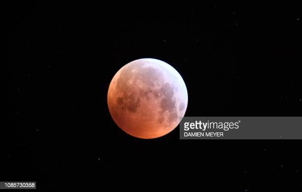 A picture taken on January 21 2019 shows the socalled Super Blood Wolf Moon over Rennes western france