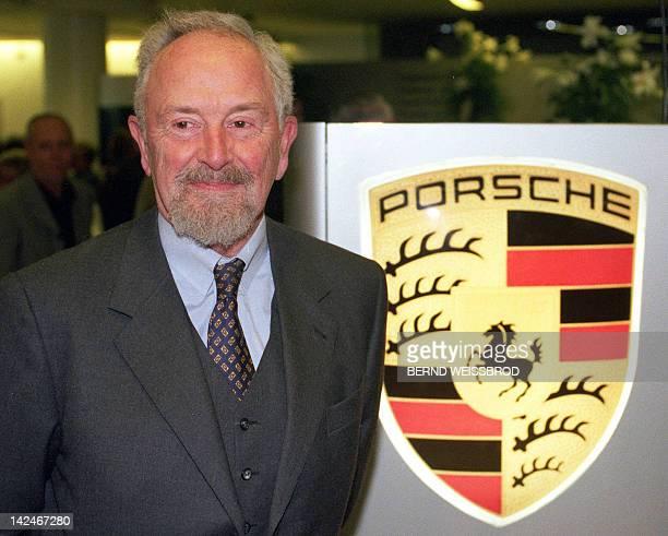 Picture taken on January 22 1999 shows Ferdinand Alexander Porsche posing next to the logo of German sports car maker Porsche in Stuttgart southern...