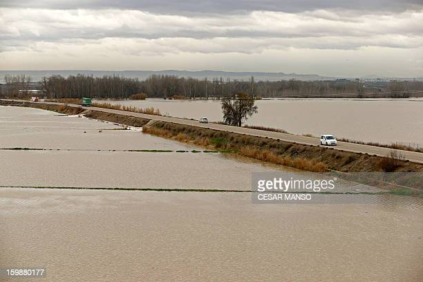 Picture taken on January 22, 2013 shows flooded areas surrounding the A-126 highway, linking Boquianeri to Novillas, near Zaragoza, following the...