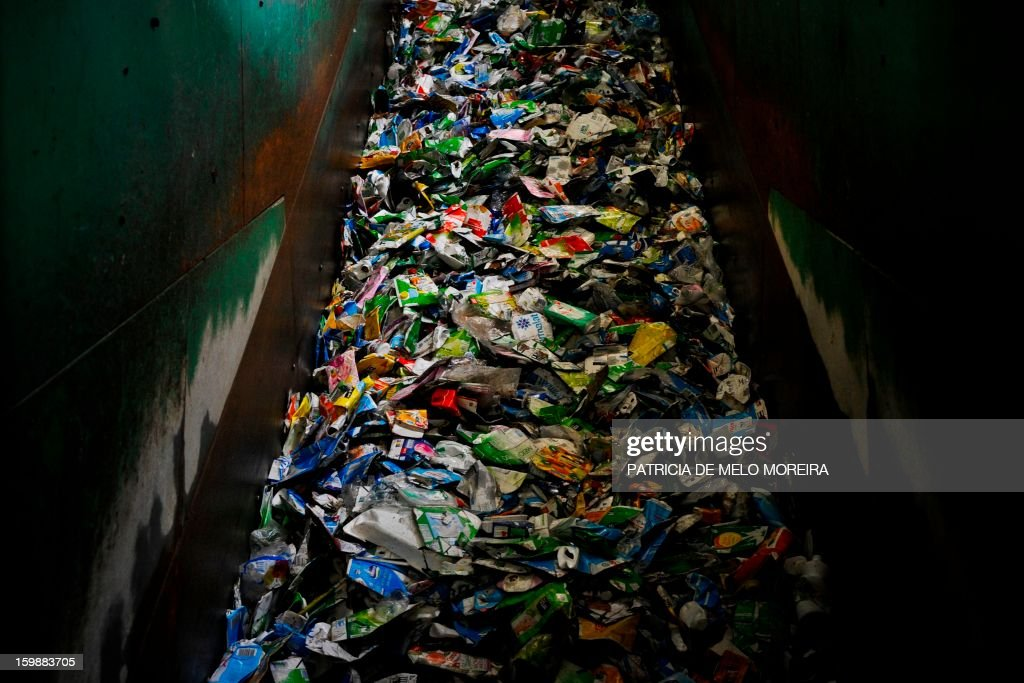A picture taken on January 22, 2013 shows packages for recycling at Valorsul, a waste treatment plant, in Lisbon.
