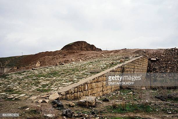 Picture taken on January 22, 2017 shows the damage caused to the Nergal Gate of the ancient city of Nineveh in eastern Mosul, after it was destroyed...
