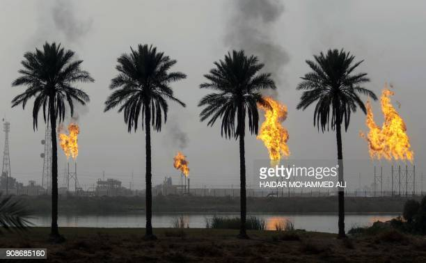 Picture taken on January 22, 2018 shows flames rising from the burning of excess hydrocarbons at the Nahr Bin Omar natural gas field, north of the...