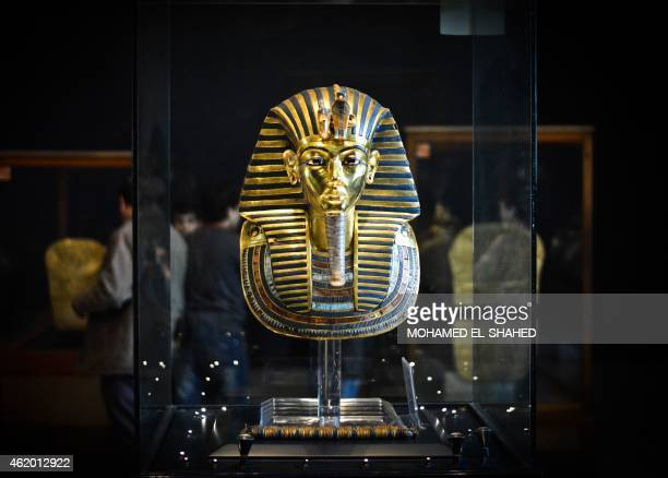 Picture taken on January 23, 2015 shows the burial mask of Egyptian Pharaoh Tutankhamun, who ruled Egypt from 1334 to 1325 BC, at the Cairo museum in...