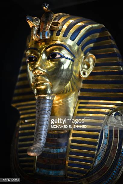 A picture taken on January 23 2015 shows the burial mask of Egyptian Pharaoh Tutankhamun who ruled Egypt from 1334 to 1325 BC at the Cairo museum in...