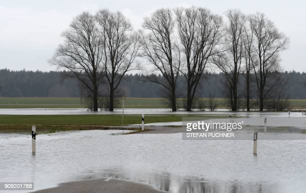 A picture taken on January 23 2018 shows an area that is flooded after the water level of the river Woernitz has risen due to heavy rains outside...