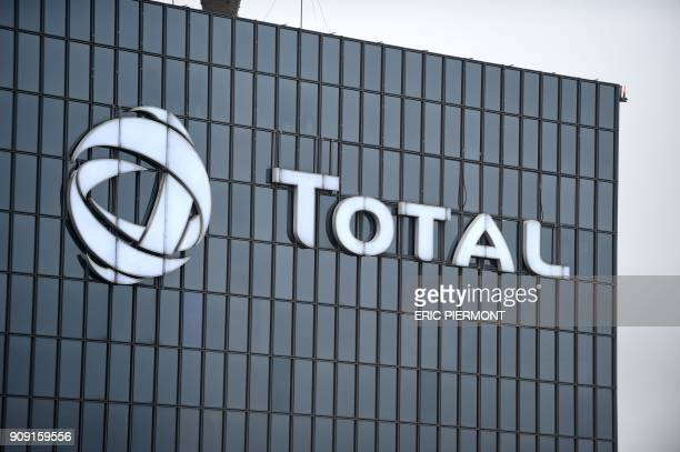 A picture taken on January 23 2018 shows the logo of Total at the company's headquarters in La Defense business district / AFP PHOTO / ERIC PIERMONT