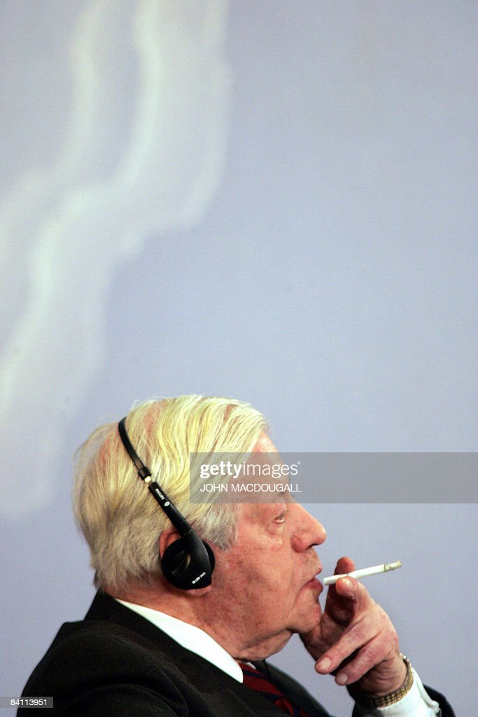 FILES - A picture taken on January 24, 2006 shows former German chancellor Helmut Schmidt smoking a cigarette as he takes part in a debate at the foreign ministry in Berlin. Schmidt celebrates his 90th birthday on December 23, 2008.