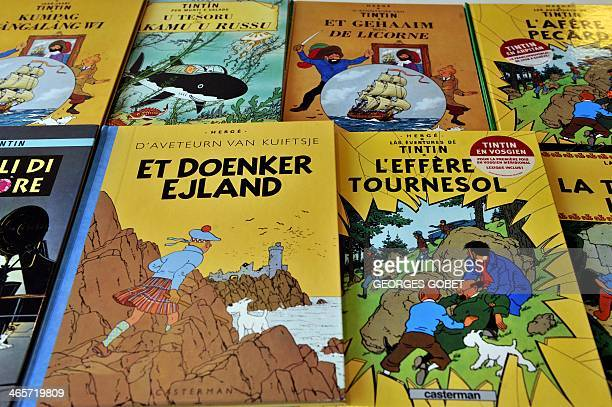 RIVET A picture taken on January 24 2014 shows covers of comics series Tintin translated in several languages at the Casterman publisher headquarters...