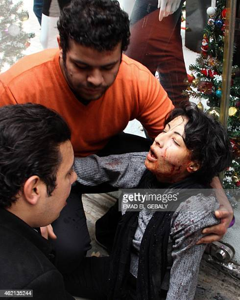 A picture taken on January 24 2015 shows Egyptian Shaima alSabbagh receiving assistance after she was injured during clashes with police during a...