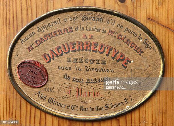 A picture taken on January 25 2010 shows a plate signed by Louis Daguerre a French artist and chemist who invented the daguerreotype process of...