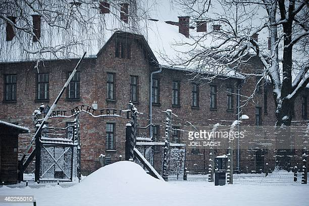 Picture taken on January 25 2015 shows the lettering 'Arbeit macht frei' at the entrance of the former Nazi concentration camp AuschwitzBirkenau in...