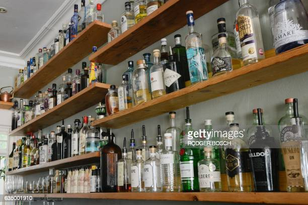 A picture taken on January 26 2017 shows the shelves of the Mothers Ruin gin bar which stocks more 144 varieties of gin in the city centre of Cape...