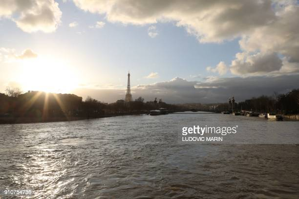 A picture taken on January 26 shows the flooded banks of the river Seine with the Eiffel Tower in the backround in Paris Leaks were starting to...