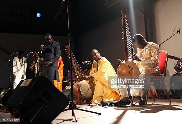 A picture taken on January 27 2016 shows Malian kora players Toumani and Sidiki Diabaté during the Bamako Acoustik Festival in Bamako The Bamako...