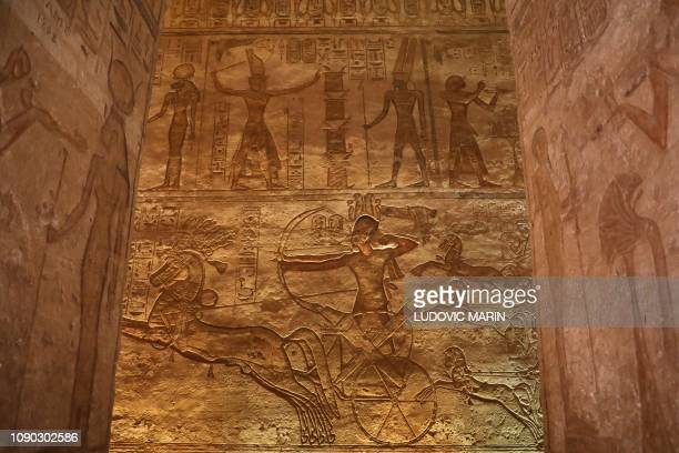 A picture taken on January 27 shows hieroglyphs and statues at the Great Temple of Abu Simbel south of Aswan in upper Egypt
