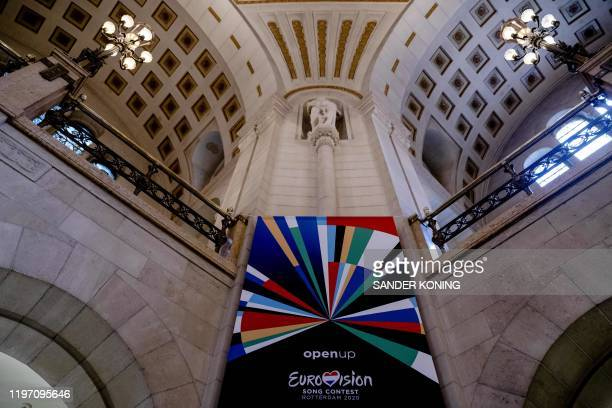 A picture taken on January 28 20120 shows a banner depicting the logo of the 65th edition of the Eurovision Song Contest in Rotterdam The 65th...