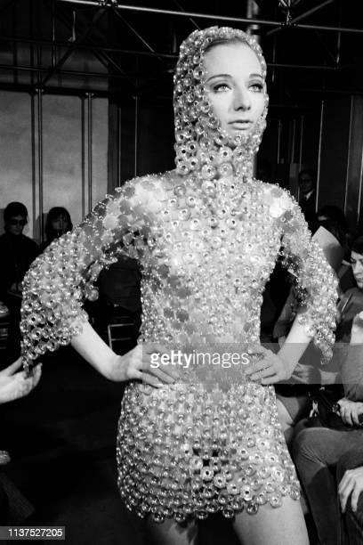 Picture taken on January 29, 1969 at Paris showing a fashion model wearing a plastic and metal dress created by Paco Rabanne for his Summer 1969...