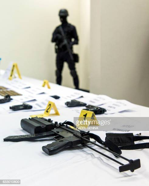 A picture taken on January 29 2017 shows a confiscated submachine gun on display during a press conference by the Central Bureau of Judicial...