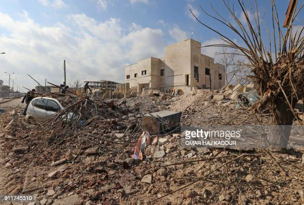 TOPSHOT A picture taken on January 29 2018 shows destruction around the Udai hospital following airstrikes by government forces on the town of...
