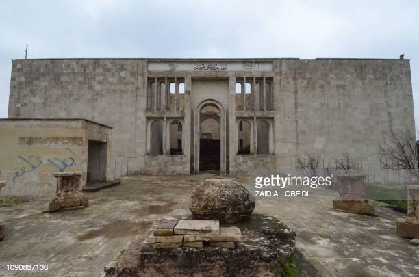A picture taken on January 29 2019 shows a general view of the exterior of the damaged museum of the northern Iraqi city of Mosul which served as the...