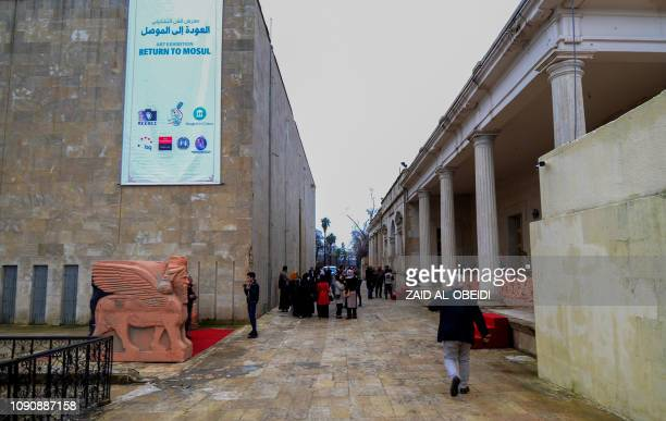 A picture taken on January 29 2019 shows Iraqis touring an exhibition at the national museum of the northern Iraqi city of Mosul which served as the...