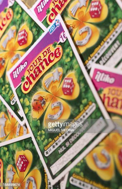 Picture taken on January 3 2013 in Paris shows a new scratchcard games called 'Jour de chance' The Française des Jeux the operator of France's...