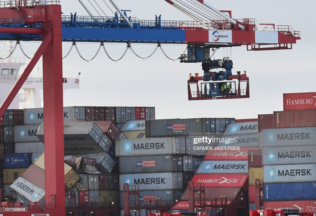 Picture taken on January 3, 2019 shows overturned containers on the