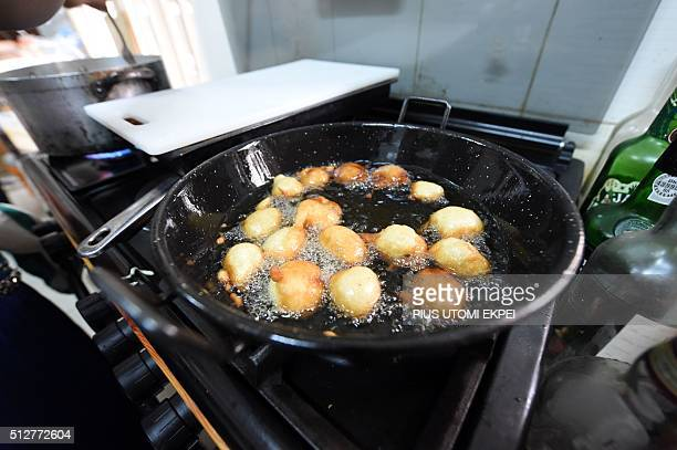 A picture taken on january 30 2016 in Lagos shows bean cakes popularly known as akara frying at cheff Ozoz Sokoh resataurant Strangers During the...