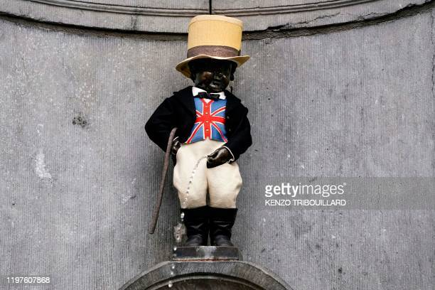 Picture taken on January 30, 2020 shows the Belgium landmark Manneken-Pis statue wearing a Union Jack flag waiscoast and a top hat to mark the...