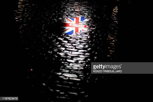 TOPSHOT A picture taken on January 30 2020 shows the reflection of a Union Jack flag on the ground during an event to celebrate the friendship...