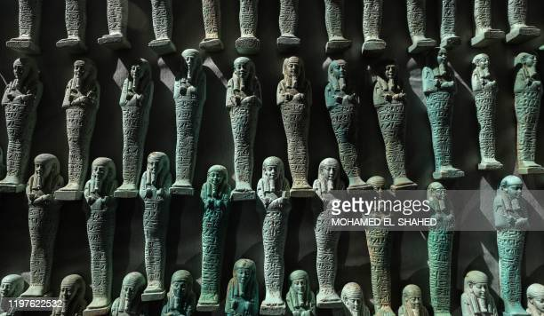 Picture taken on January 30 shows a collection of Ushabtis or funerary figurines discovered among many archeological finds in 3000-year-old communal...