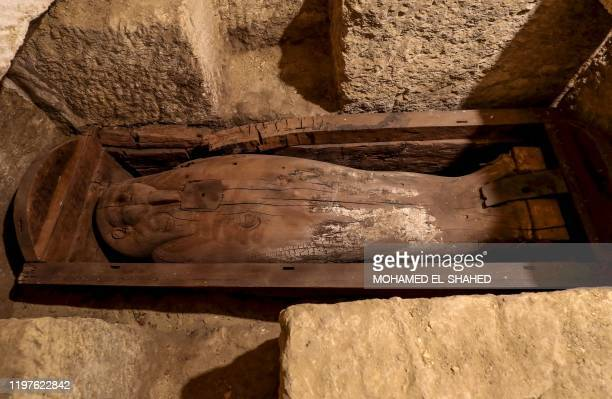 Picture taken on January 30 shows a wooden sarcophagus discovered among many archeological finds in 3000-year-old communal tombs dedicated to high...