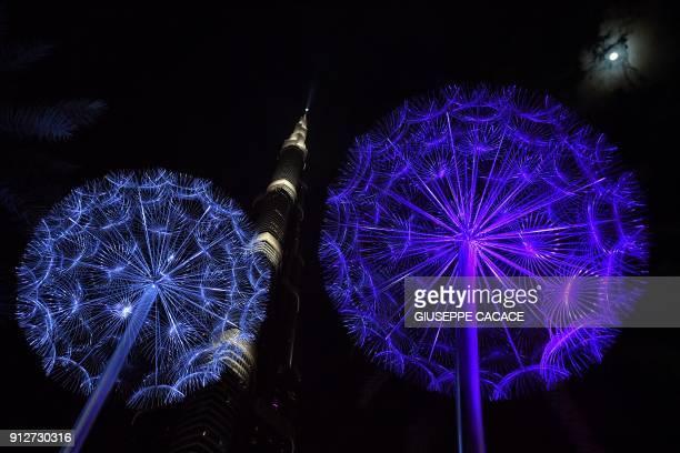 A picture taken on January 31 2018 shows decorations around Dubai's Burj Khalifa / AFP PHOTO / GIUSEPPE CACACE