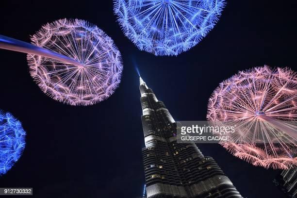 TOPSHOT A picture taken on January 31 2018 shows decorations around Dubai's Burj Khalifa / AFP PHOTO / GIUSEPPE CACACE