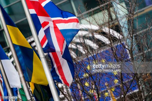 A picture taken on January 31 2020 shows the British Union Jack waving in front of the European Parliament in Brussels on the Brexit day Britain's...