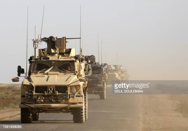 A picture taken on January 31 shows US armoured vehicles patrolling in the countryside of the eastern Syrian Deir Ezzor province