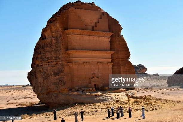 Picture taken on January 4 shows the Qasr al-Farid tomb carved into rose-coloured sandstone in Madain Saleh, a UNESCO World Heritage site, near Saudi...