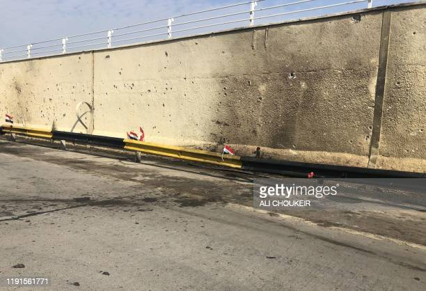 A picture taken on January 4 shows the site where top Iranian commander Qasem Soleimani and Iraqi paramilitary chief Abu Mahdi alMuhandis were killed...