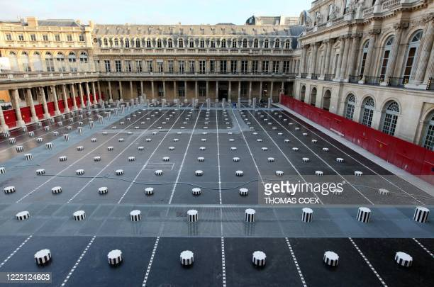 A picture taken on January 5 2010 shows the Daniel Buren columns set up in the inner yard of the Palais Royal in central Paris The columns will be...