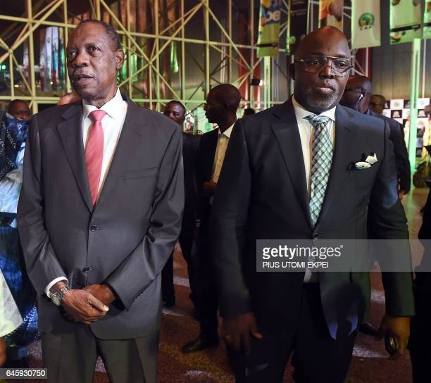 A picture taken on January 5 2017 shows president of the Nigerian Football Federation Amaju Pinnick standing beside incumbent president of the...