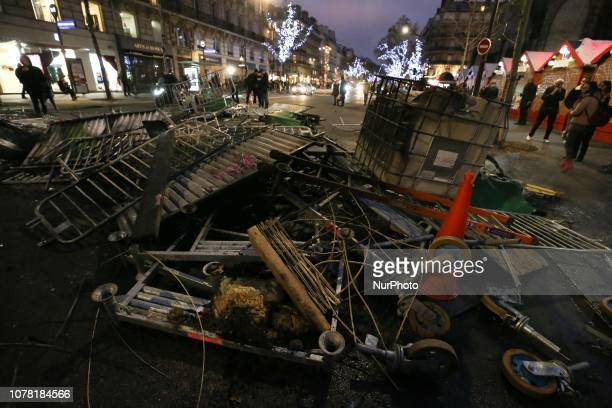 A picture taken on January 5 2019 at he SaintGermain boulevard in Paris shows a barricade set up during a demonstration called by the yellow vests...